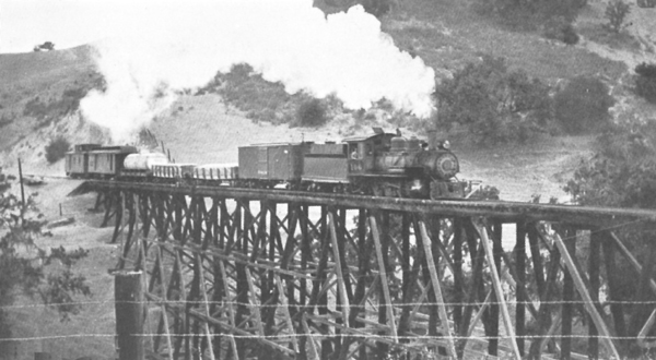 A photo taken in late 1933 shows the narrow- gauge train crossing a trestle near Los Olivos on one of Pacific Coast Railway's final runs.