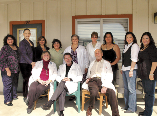 Staff from Buellton Medical Center gather for a photo. Front from left: Myra Howard, FNP, Willliam Van Valin, MD and Wolfgang Hallhauer, MD. Back from left: Porfidia Coronado, Jeannette Sackett, Virginia Moreno, MFT,  Teresa Aldana, Jennifer Kissinger, MD, Paula Bagalio, NP, Martha Jimenez, Anna Careño and Maria Hernandez.