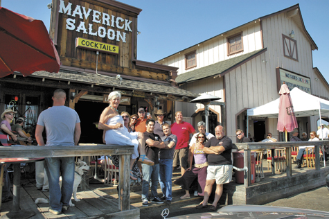 A recent Saturday afternoon finds a mixed group of locals and tourists enjoying the sun and country music on the outdoor deck at the Maverick.